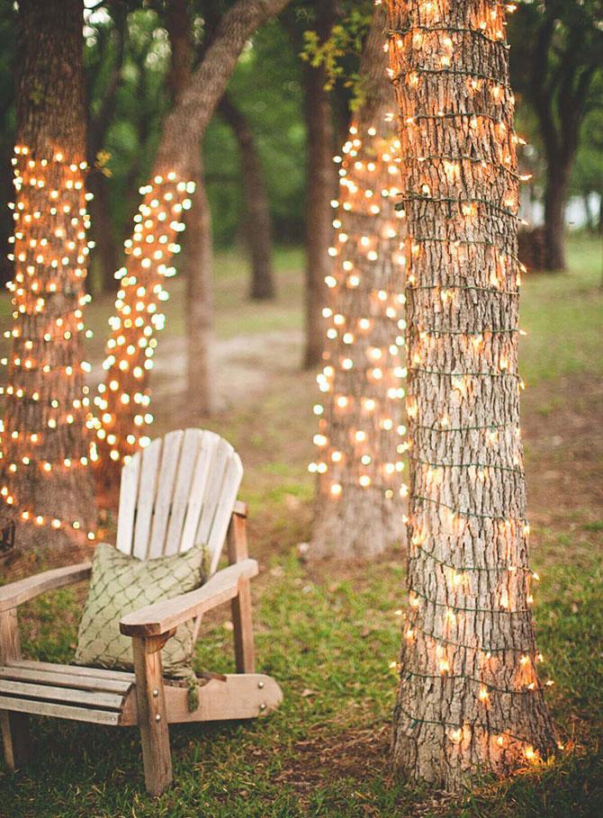 Creative outdoor tree lighting for a garden party.