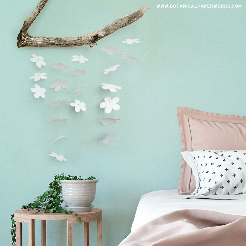Learn how to make this unique wall art using a branch you can find outside and plantable seed paper. It's a beautiful touch of nature to add to a bedroom or living area!