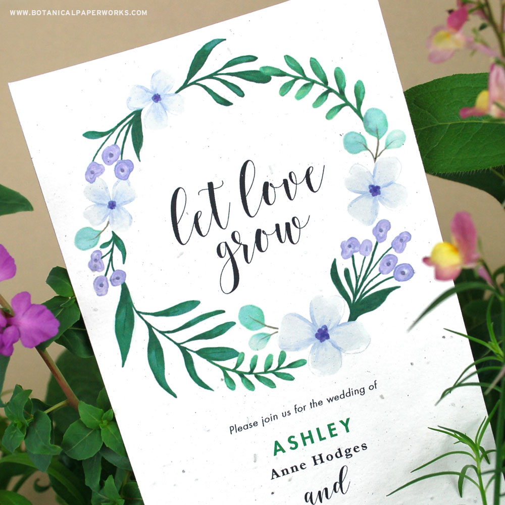 These illustrated wedding invitations feature a lush floral design surrounding beautiful calligraphy with the words, let love grow; a beautiful tribute to the nature of love and how you must allow it grow and flourish.