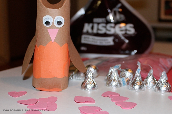 Your kids will love opening these Upcycled Love Bird Valentine Crafts to find plantable Heart Shaped Confetti pieces and Hershey's Hugs & Kisses!