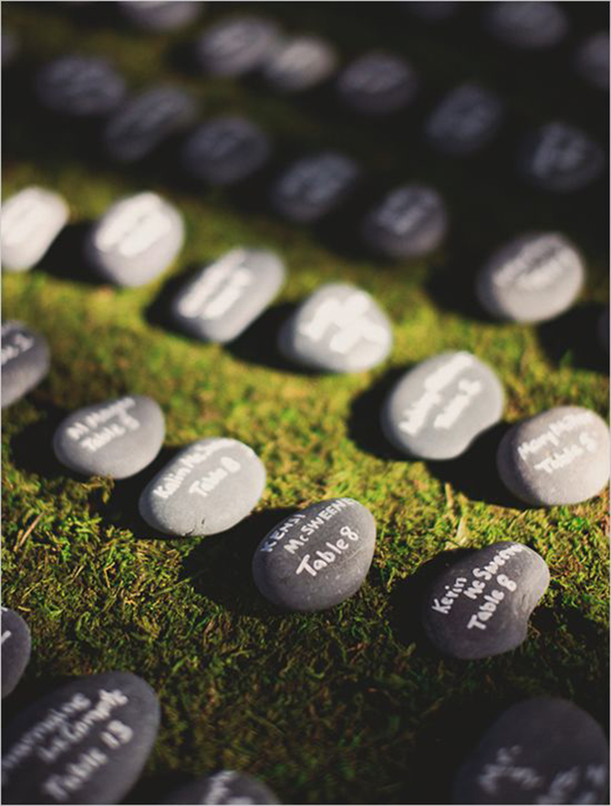 Pebbles are the perfect way to let your wedding guests know where they'll be sitting at Eco-friendly Weddings.