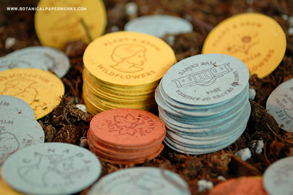 Each coin is embedded with wildflower seeds that grow when planted.