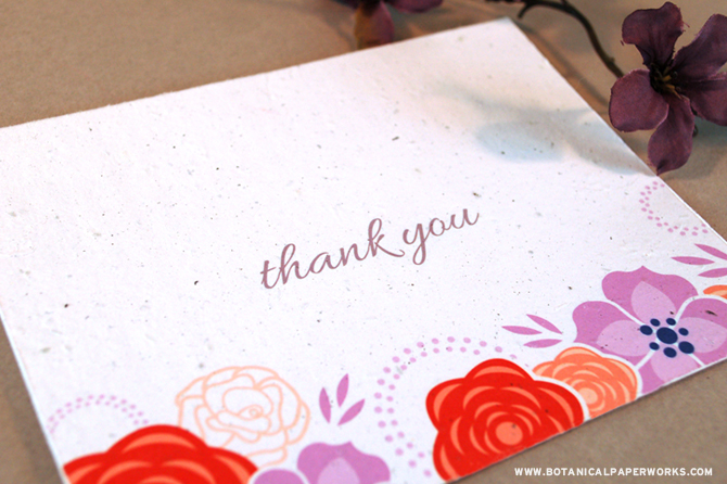 A cheerful floral design that says thank you by actually growing REAL flowers.