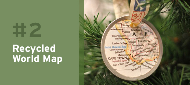 If you and your family members are passionate about traveling, a unique idea is to cut out all of the places you've adventured to from an old recycled map of the world and use the pieces to create holiday ornaments.
