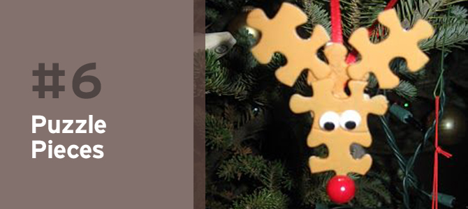 Here's an upcycle Christmas ornament idea that the kids will definitely be excited about! Using a few old puzzle pieces, arrange them in the shape of a reindeer head and get them to paint it a brown color. After that has dried, attach some eyes, ribbon and, of course, the red nose!