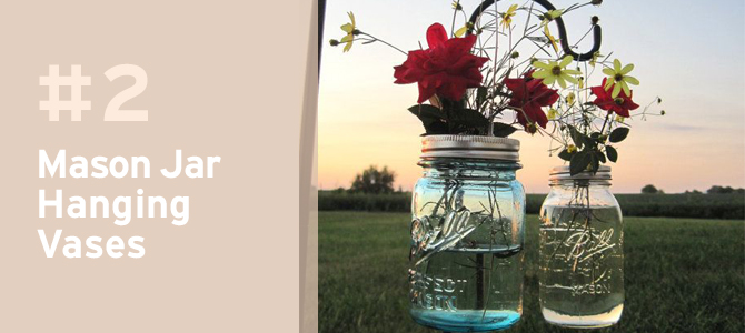 Hanging mason jar flower vases make the perect decor to welcome your guests.