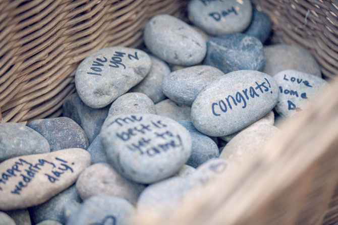 Replace your guest book with smooth stones for guests to write well wishes and sign as an all-natural solution for an eco-friendly wedding.