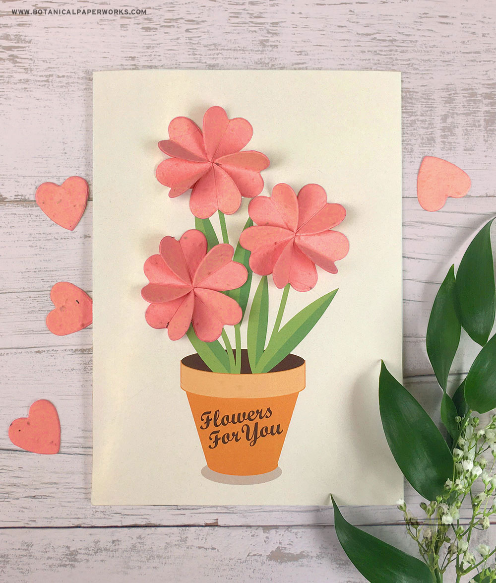 Use heart-shaped seed paper confetti pieces to make this beautiful handcrafted paper flower card.