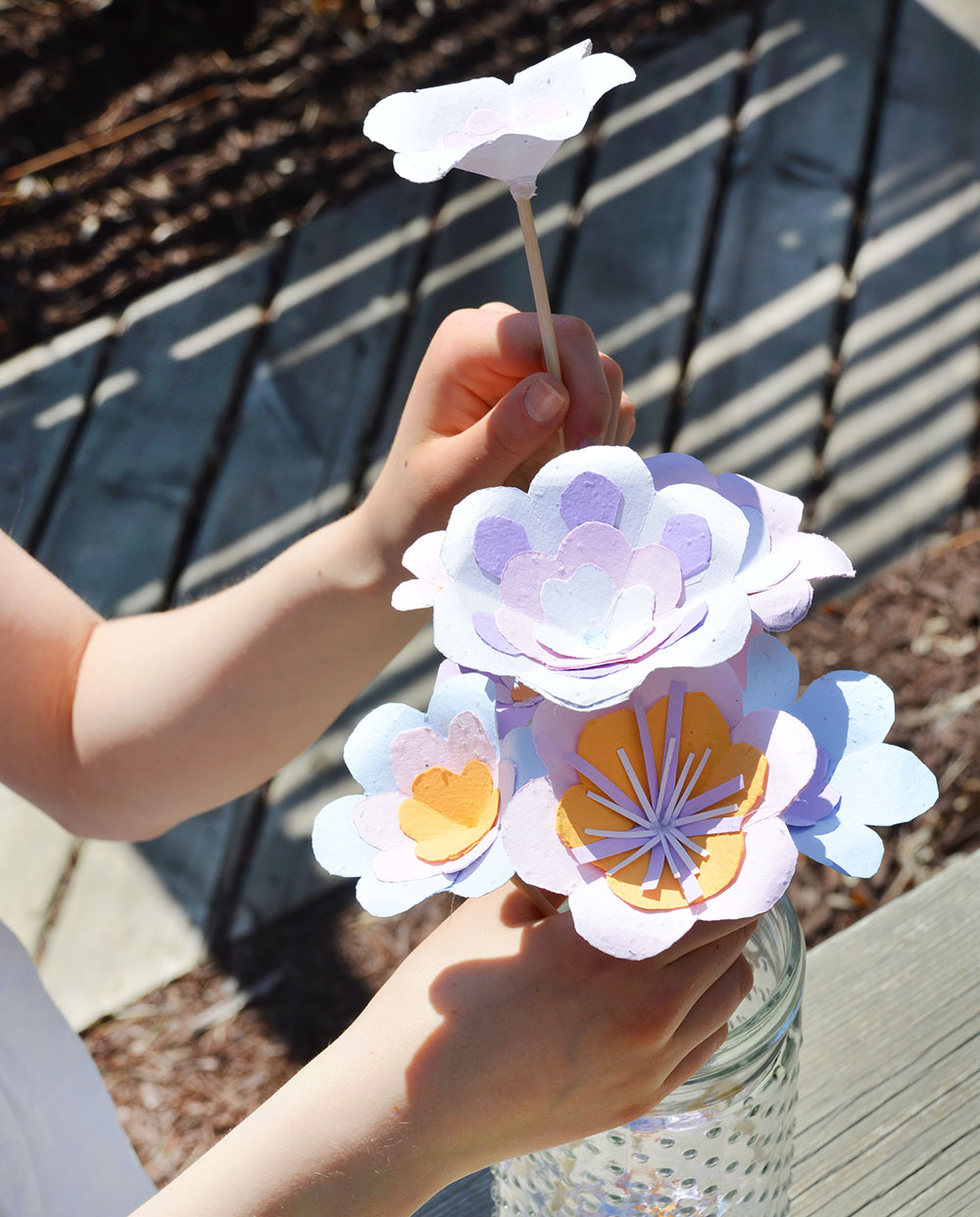 Make pretty seed paper flowers for summer wedding centerpieces & bouquets in this craft tutorial.